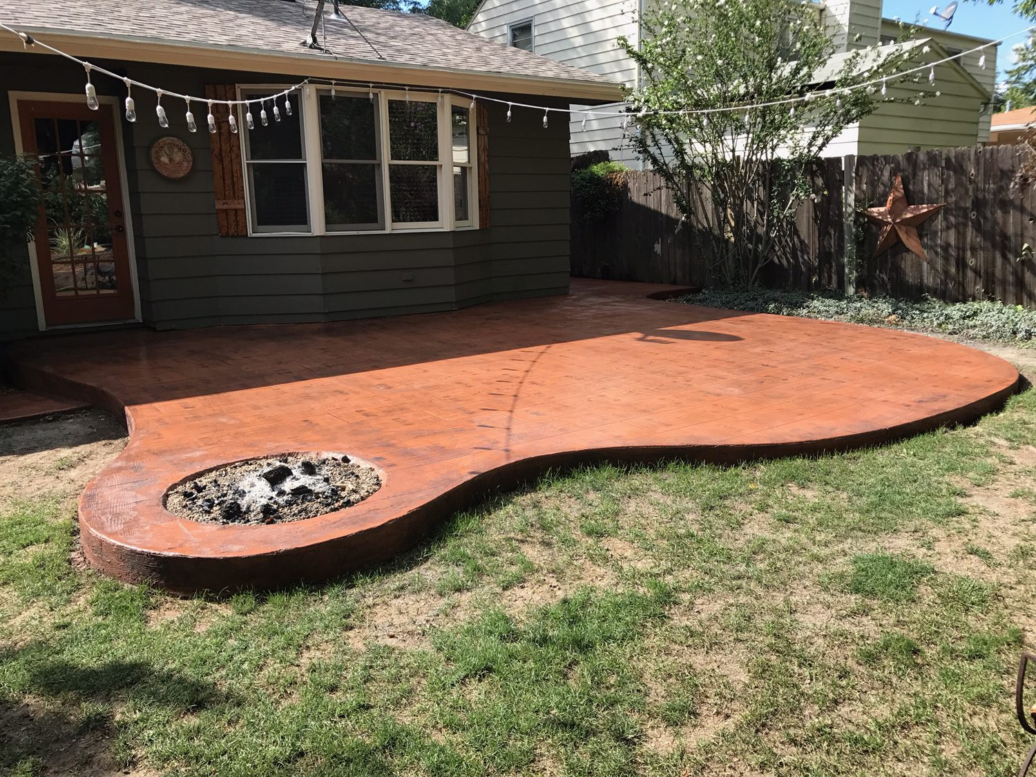 This incredible faux wood patio look was achieved with stamped colored concrete for homeowners in urbandale ia