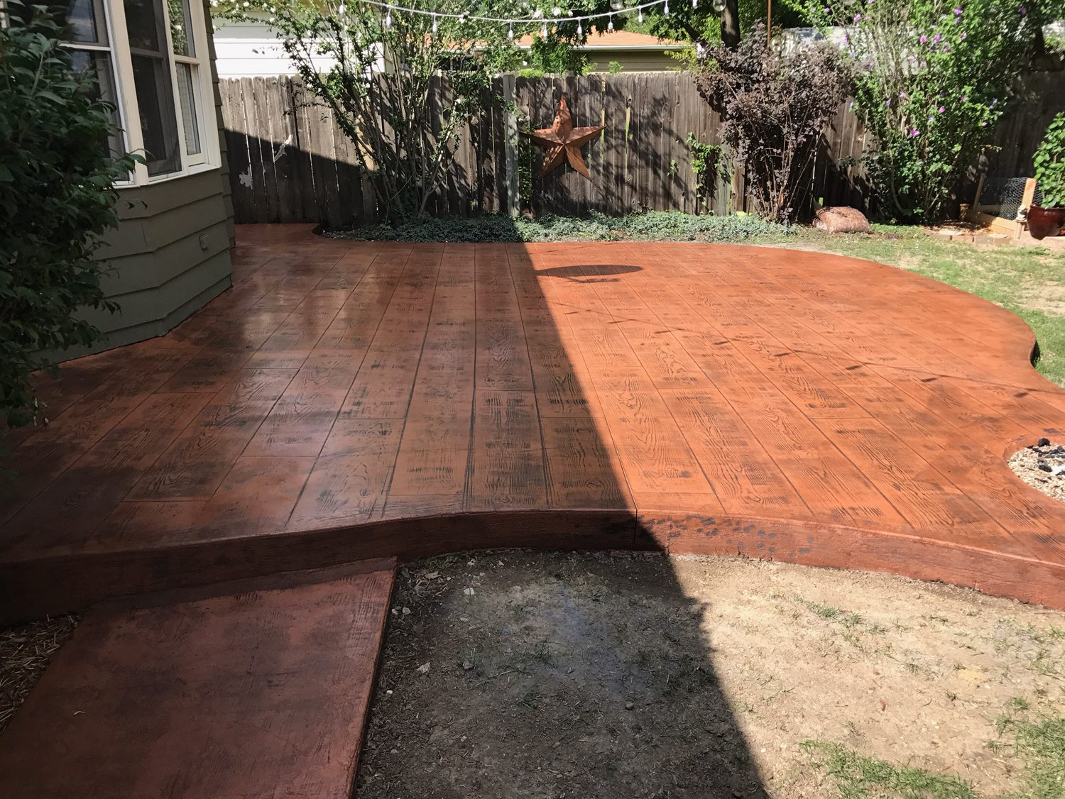 Faux Wood Stamped Colored Concrete Patio All Iowa